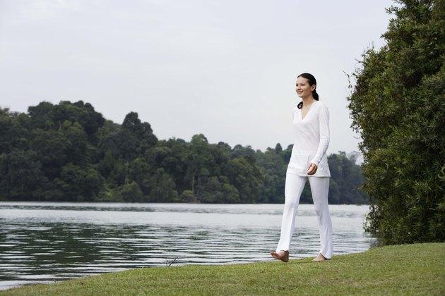 Woman walking by lake