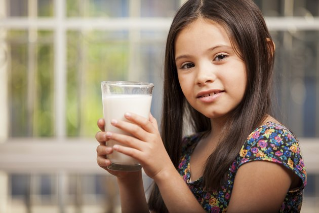 Cute girl with a glass of milk