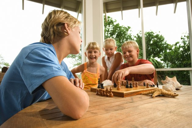 Girls Watch While Boys Play Chess