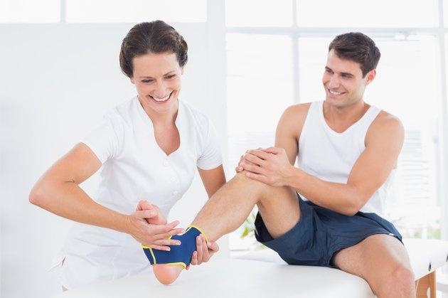 Doctor examining her patient foot