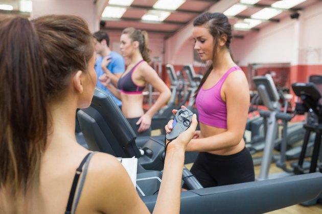 Gym Instructor using stopwatch