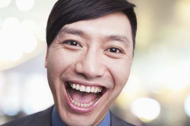 Close-up portrait of young man laughing, Beijing