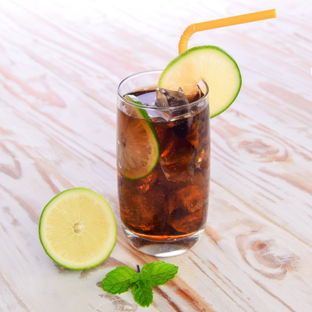 Cool Cola Drink With Lemon and Ice cube