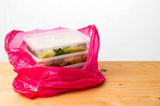 Convenient but unhealthy disposable plastic lunch boxes with meal