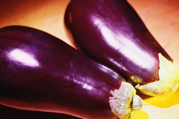 Two whole eggplants