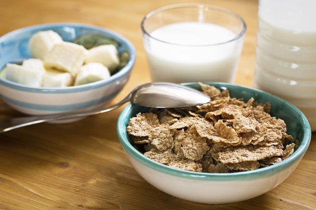 Delicious and healthy wheat flakes in bowl with milk