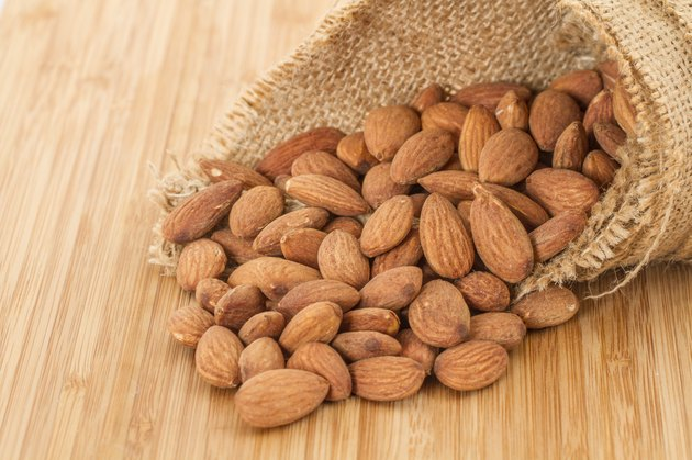 Almonds in a brown straw sack
