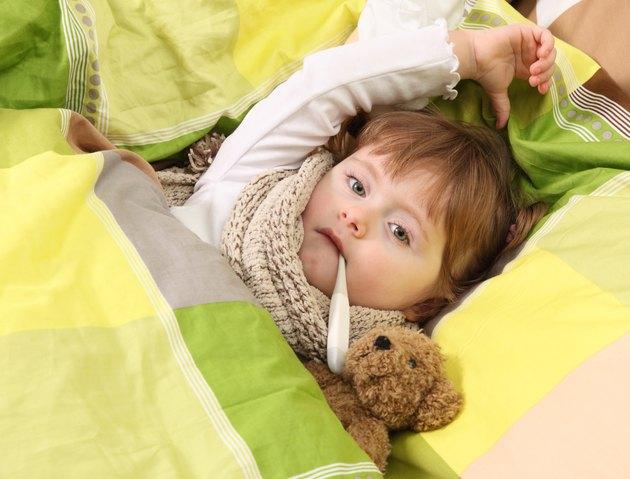 Little girl lying sick