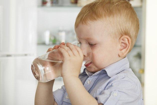 little boy drinks water