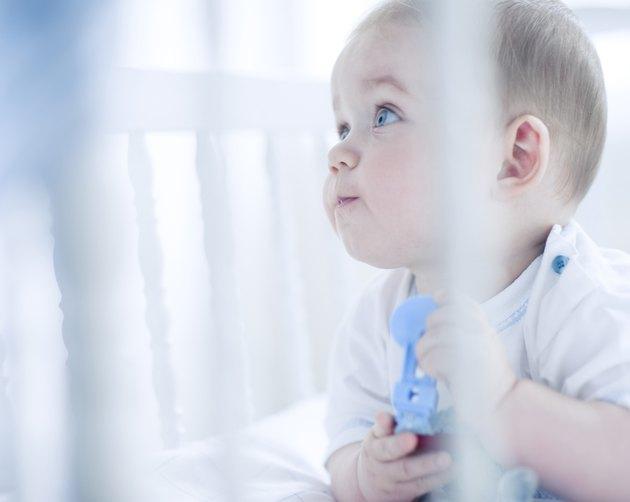 Baby boy in cot
