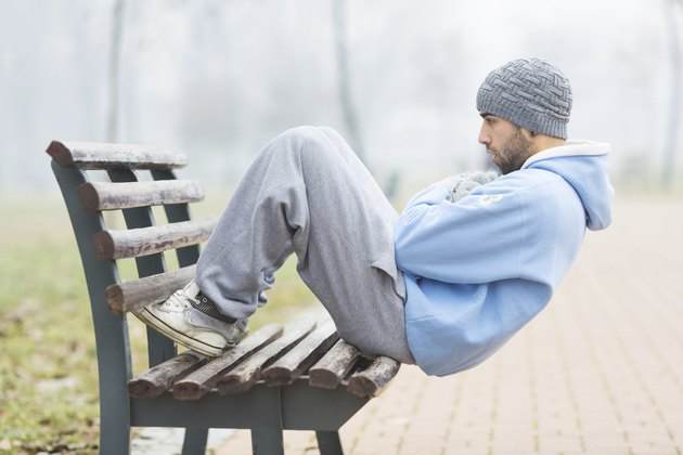 Young man doing sit ups