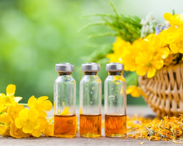 Bottles of healing plants treatment and healthy herbs