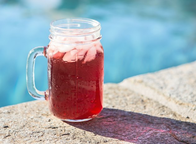 Old fashioned drink on ice by the pool