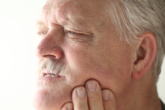 Senior man has jaw or tooth pain