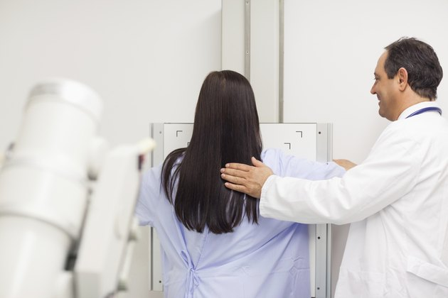 Doctor doing a mammography on a patient
