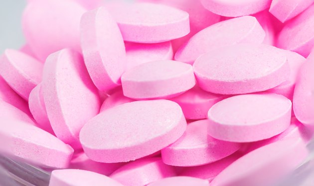 The pink tablets isolated on white background