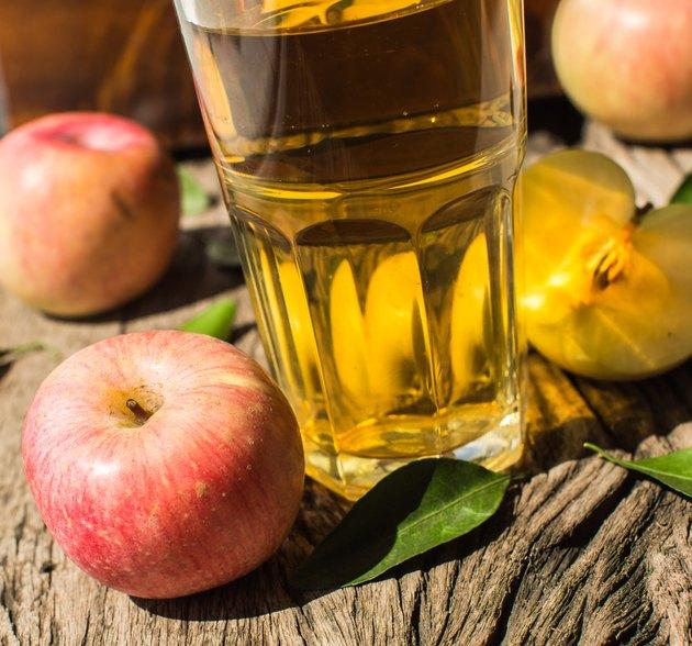 Apple juice on a wooden board