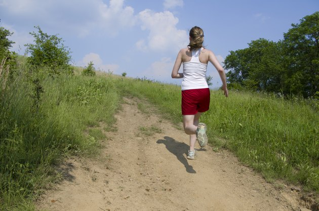 Woman running uphill