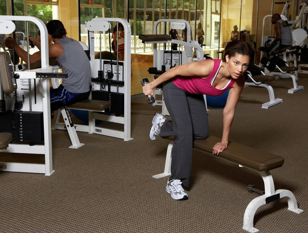 Man and woman doing exercise in gym