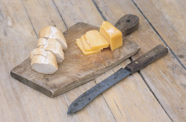 Sliced bread and cheese on cutting board
