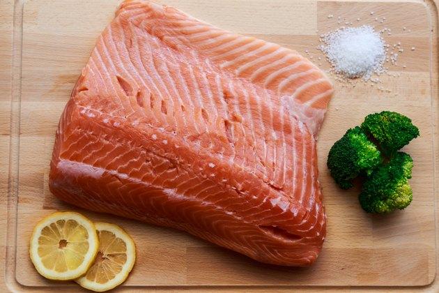 Raw salmon with broccoli, lemon and salt.