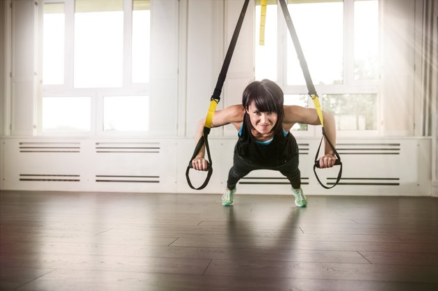 Woman during suspension training