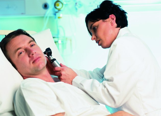 A female doctor checking a patient's ear with a scope