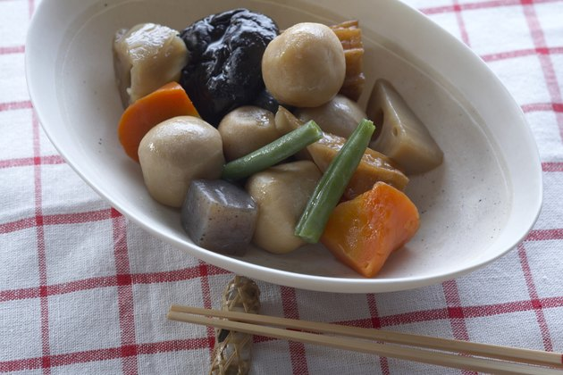 Bowl of Japanese vegetables with chopsticks, close-up