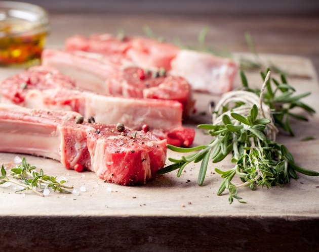 Raw meat, mutton, lamb rack on a wooden background