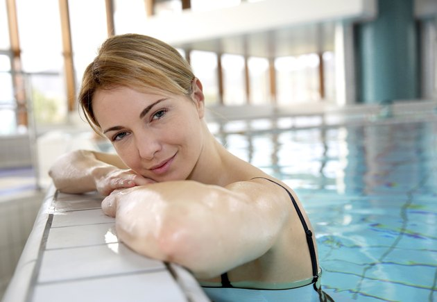 Blond woman relaxing in a swimming pool