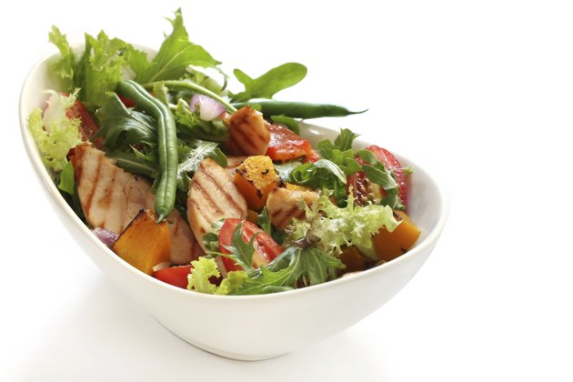 A grilled chicken salad in a bowl