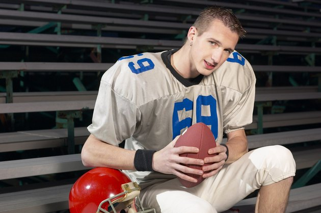 Football player in bleachers