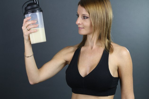 beautiful woman looking a protein shake