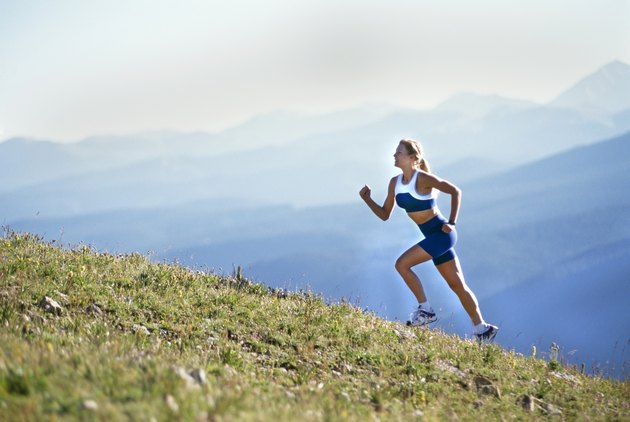 Beautiful Woman Running up Mountain