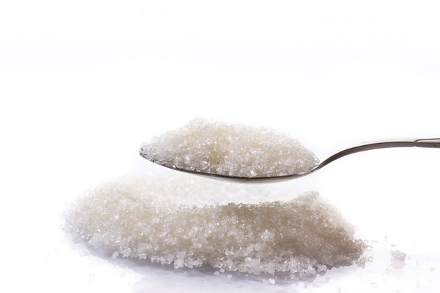 granulated sugar in a spoon
