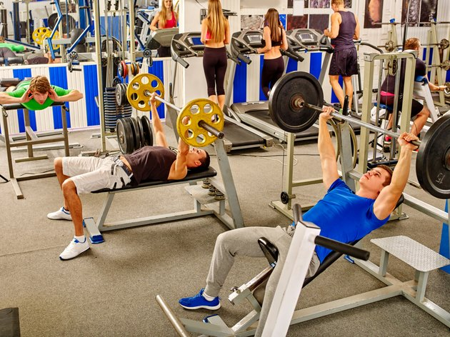 Group of people  working his body at gym