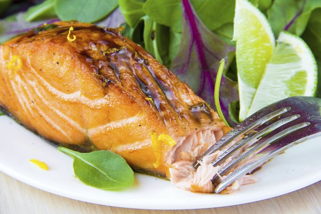 Grilled fillet of red salmon and salad with lettuce