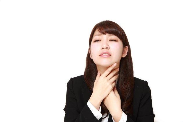 businesswoman having throat pain