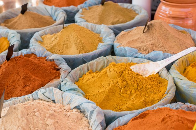 colorful piles of spices sold in spice market