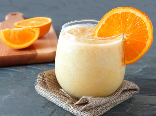 Orange fruit smoothie in a stemless glass
