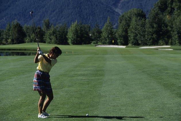 Female golfer ready to swing, Sun Valley, Idaho, USA