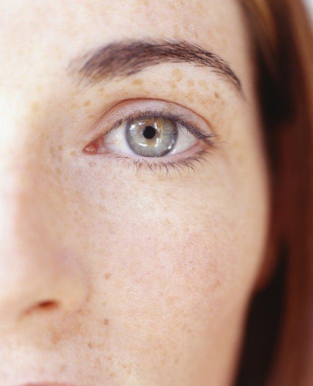 Woman looking at camera, (Close-up)