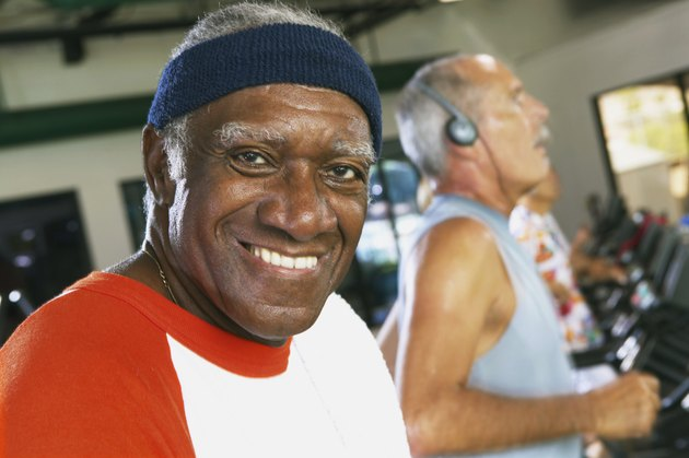 Senior man in gym, smiling, portrait, close-up