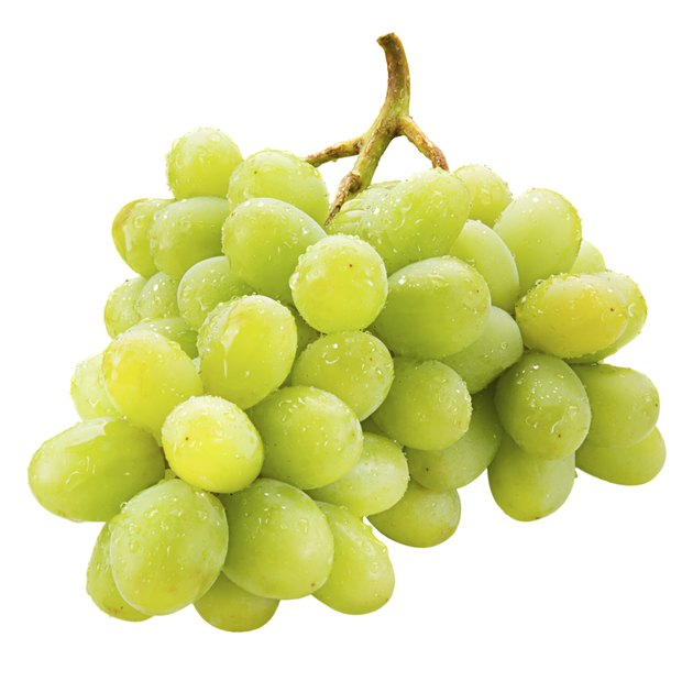 Fresh green grapes with drops Isolated on white