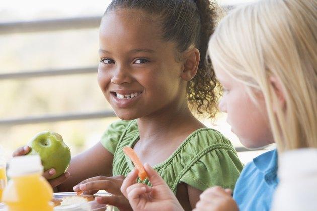 Kindergarten children eating lunch