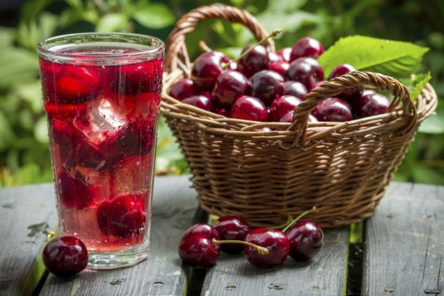 Freshly harvested sweet cherries and juice from them with ice