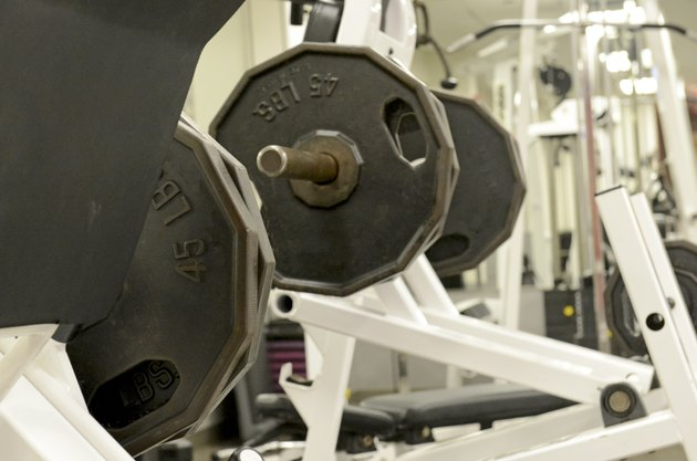 Iron weight plates and exercise equipment in gym