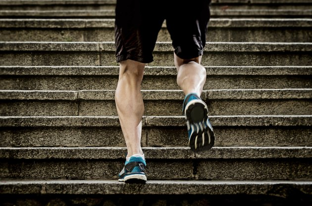 athletic sport runner man running up stairs in urban training