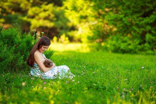 Mom feeds the baby, breastfeeding,summer