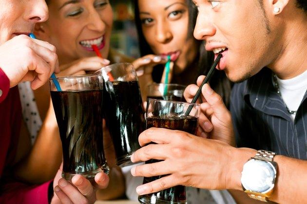 Friends drinking soda in a bar